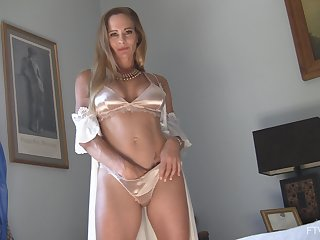 Classy matured solo amateur MILF model Eve strips sensually