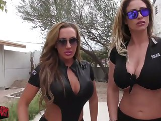Two mega busty policewomen give an intensive tugjob in public