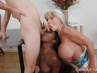 Busty mature loves helping this ebony babe with the obese dick