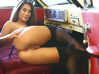 Eva Lovia in sexy lingerie masturbates in the retro car