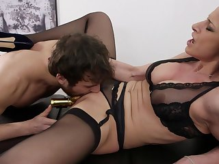 MILF spreads legs for young man's stimulated dick