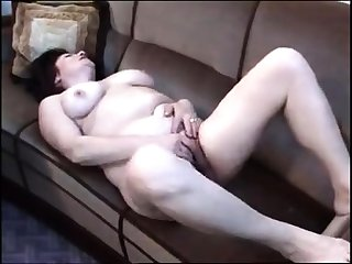Busty brunette mature rubs her perishable cunt