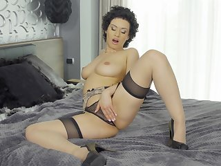 Appealing woman masturbates in her black lingerie plus shows real apogee